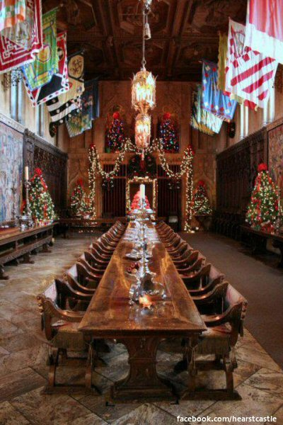 The grand dining room  decorated for Christmas