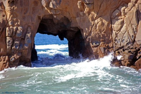 Daylight and high tide view of Keyhole Arch at Pfeiffer Beach, Big Sur
