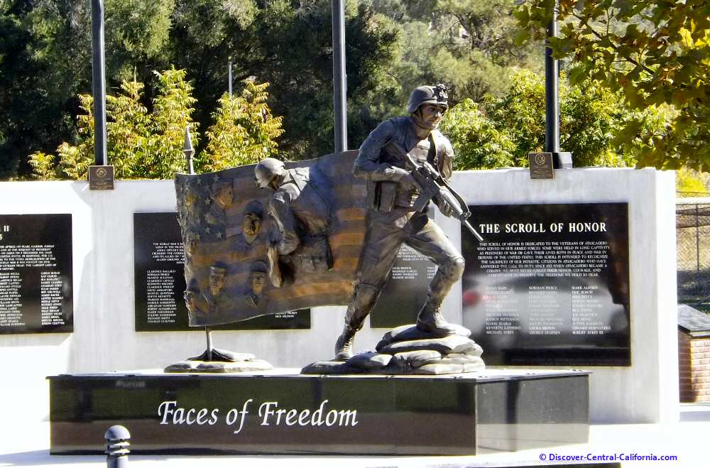Faces of Freedom statue and the Heroes Wall behind