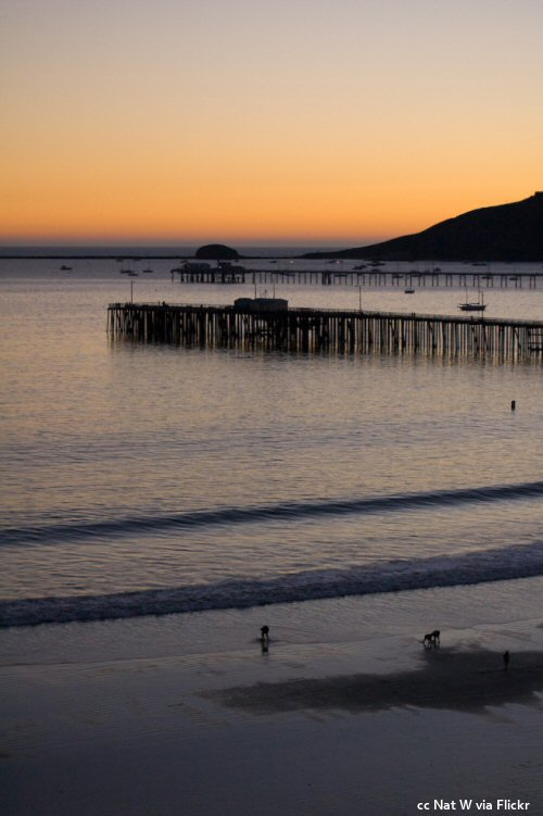 Sunset at Avila Beach with the piers and Whalers Rock in the distance