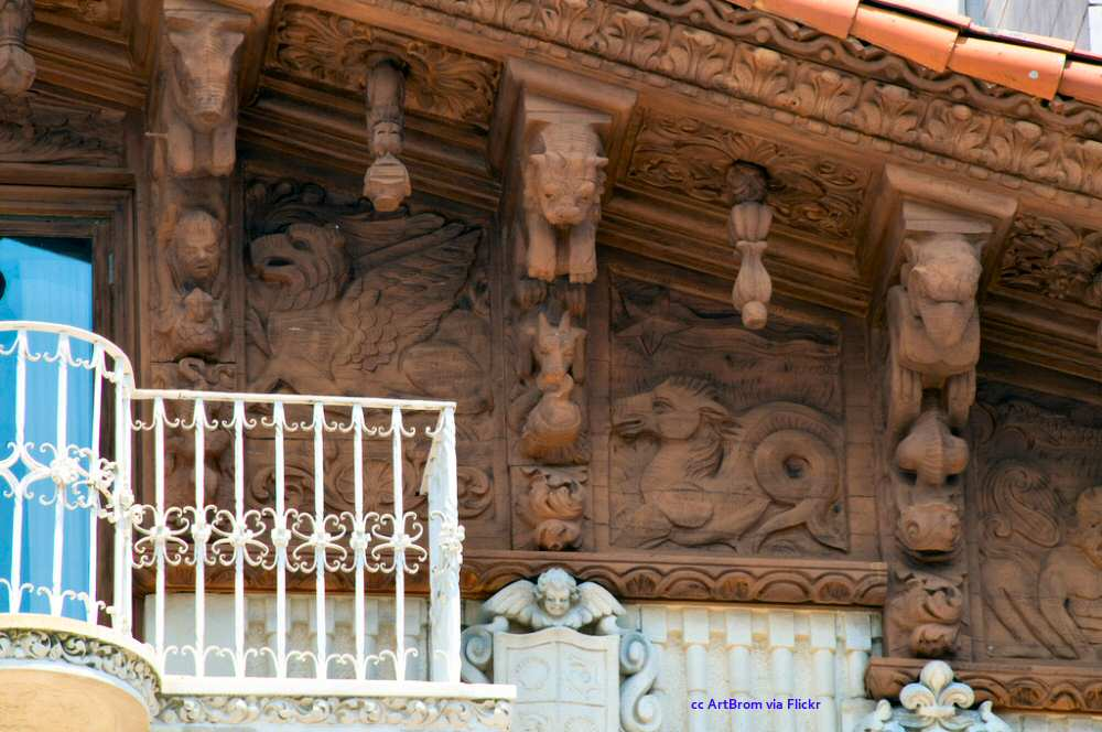 Detailed wood carvings surround a balcony