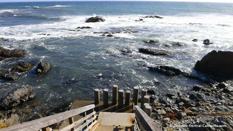 The view down to the beach at Lampton Cliffs Park in Cambria at high tide