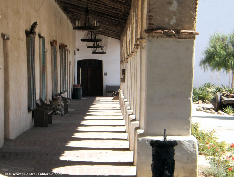 A view down the front collondade to the side door of the church