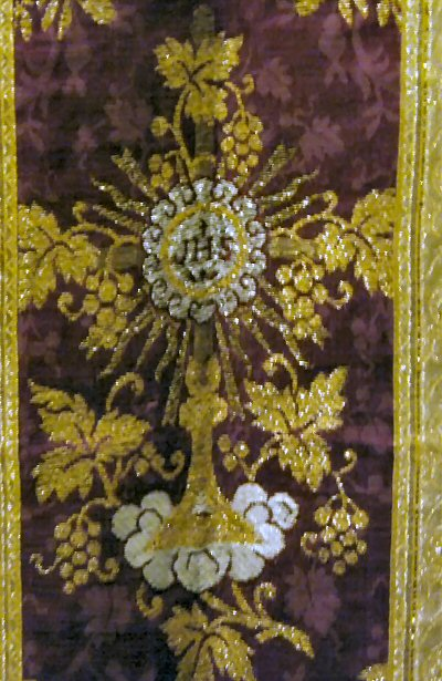A detail of an historic chasuble at the museum at Mission Santa Ines showing intricate needlework