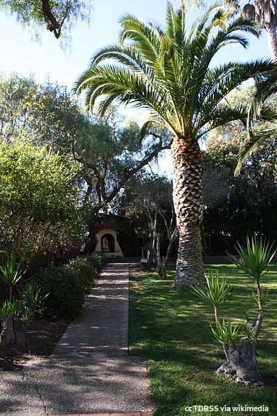 A peaceful view of the garden at Santa Ines Mission in Solvang