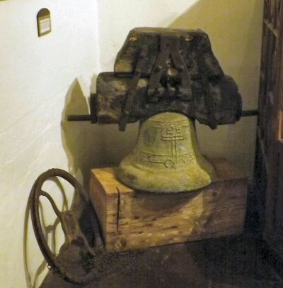 An old mission bell in the museum at Mission Santa Ines