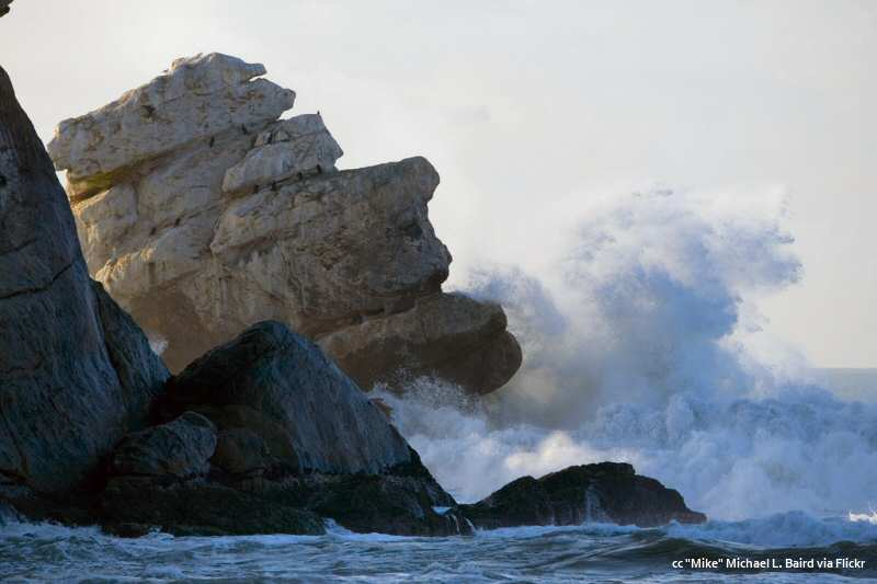 Morro and Pillar Rocks in big surf