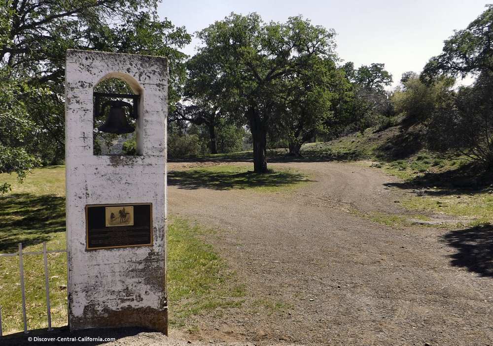 Bell and plaque at a ranch entrance