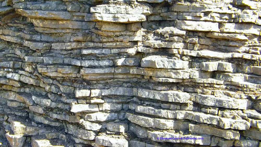Closeup of well defined rock layers along the road