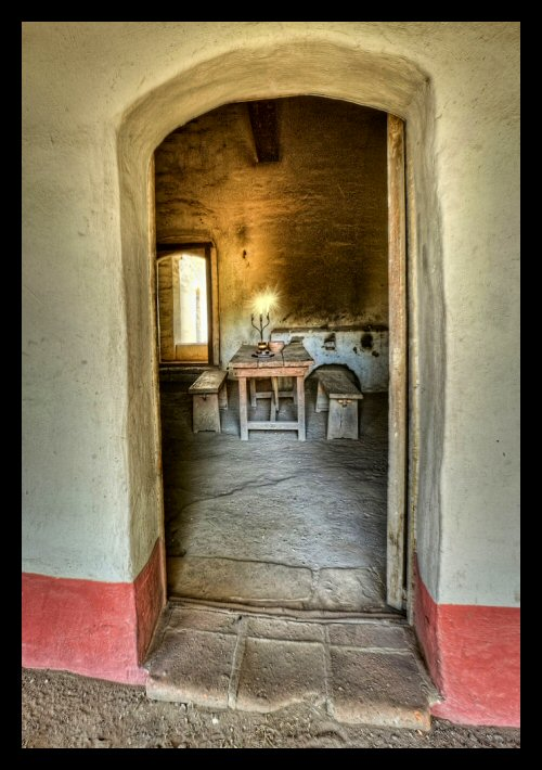A view to the interior of a restored room at Mission La Purisima