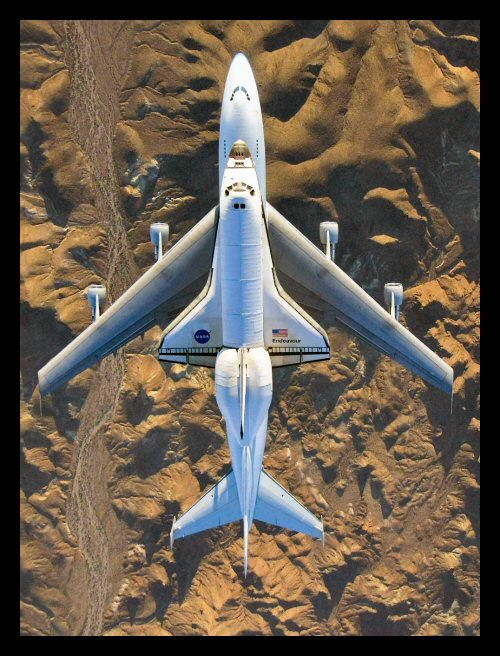 The space shuttle Endeavour being ferried on a 747