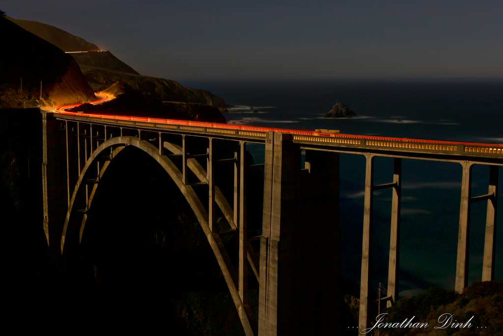 A timelapse of the Bixby Bridge with streaks of tailights