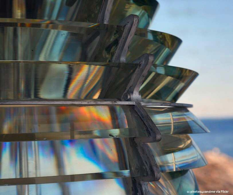 A closeup of the beautifully crafted glass of a Fresnel lens from a lighthouse