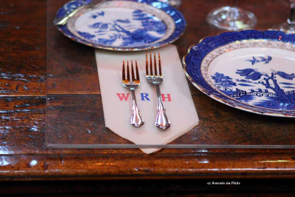 Dining room place setting with monogrammed paper napkin
